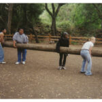 Youth Carrying Log
