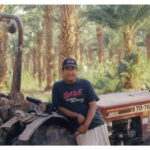 Teen Posing with a Tractor